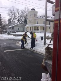 Lt. Marvin and Firefighters Stevens and Doepner dig out a hydrant.